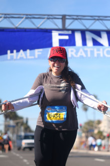 Aurora smiling at the end of Surf City half marathon 2012