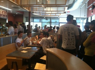 long line of cyclists at Chipotle, waiting for free burritos after the race