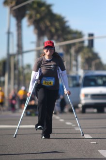 Aurora De Lucia coming into the surf city half finish line after a half marathon on crutches