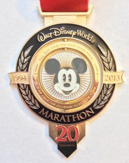 "Marathon medal from 20th anniversary of the Walt Disney World Marathon (2013) - It says ""all our dreams can come true, if we have the courage to pursue them"""