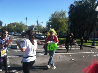 a guy in a funny hat with a makeshift beer station during Rock 'n' Roll New Orleans half marathon 2012