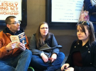new friends playing games passing time in the Book of Mormon standing room line