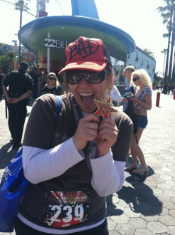 Aurora De Lucia posing with her medal at the Hollywood Half Marathon 2012