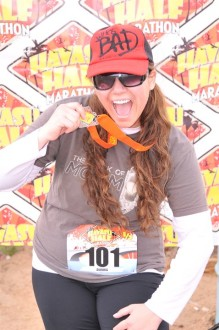 Aurora posing with her medal from the Havasu half