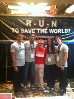 Aurora posing with members of the Run Project team at the Hollywood Half Marathon expo 2012