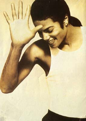 Michael Jackson with the sexy looking down, hand sort of in front of face pose from the In The Closet video