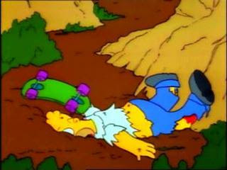 Homer Simpson face down, banged up and bloody after falling down Springfield Gorge