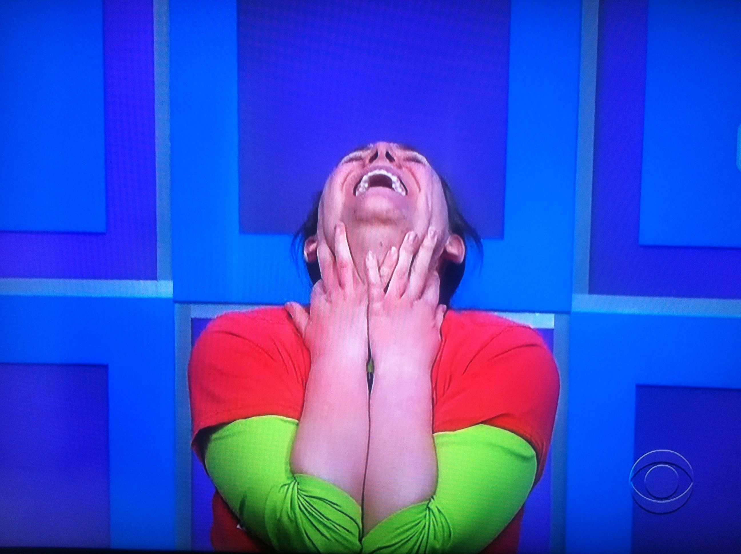 Aurora on the ground with her head back, playing for a brand new car on The Price is Right