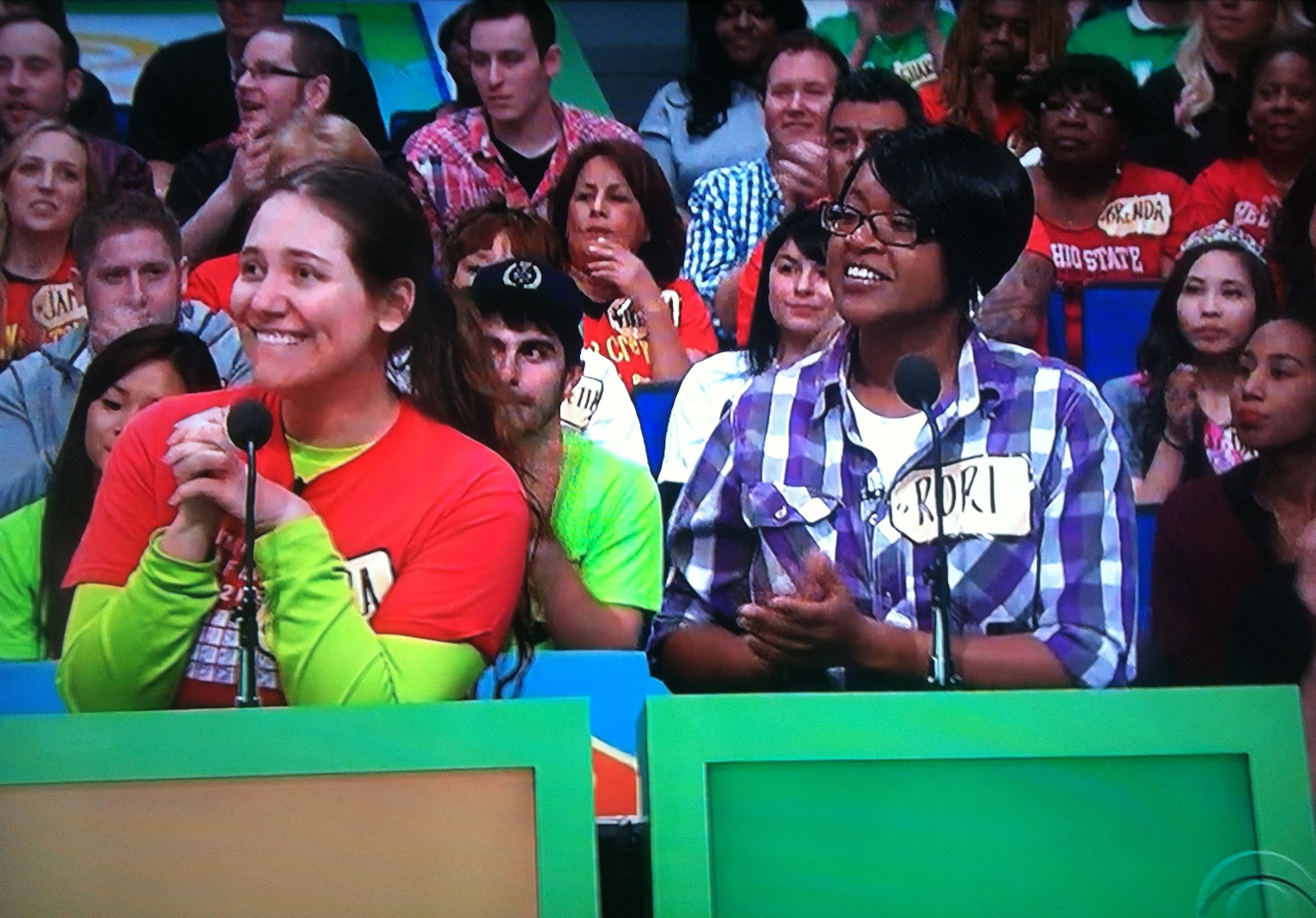 Aurora De Lucia in contestant's row on The Price is Right, looking like she really wants those camcorders