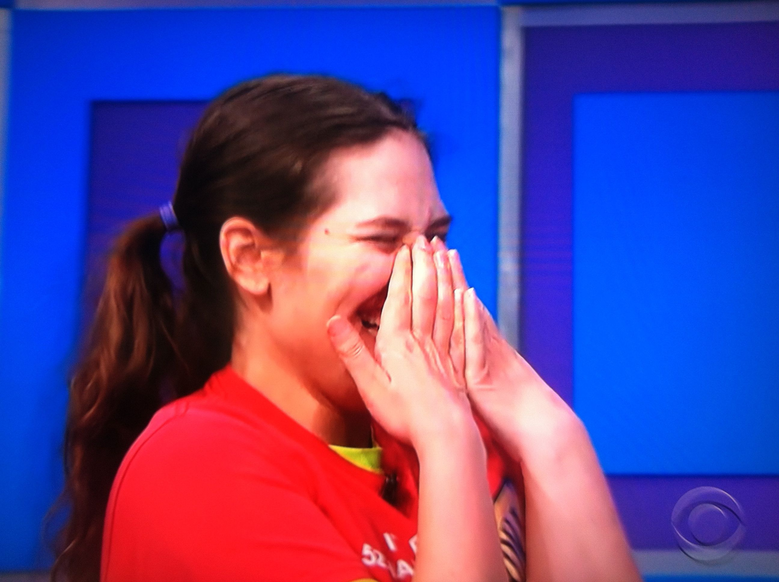 Aurora De Lucia with a huge smile/laugh as Drew Carey makes fun of her on the Price is Right