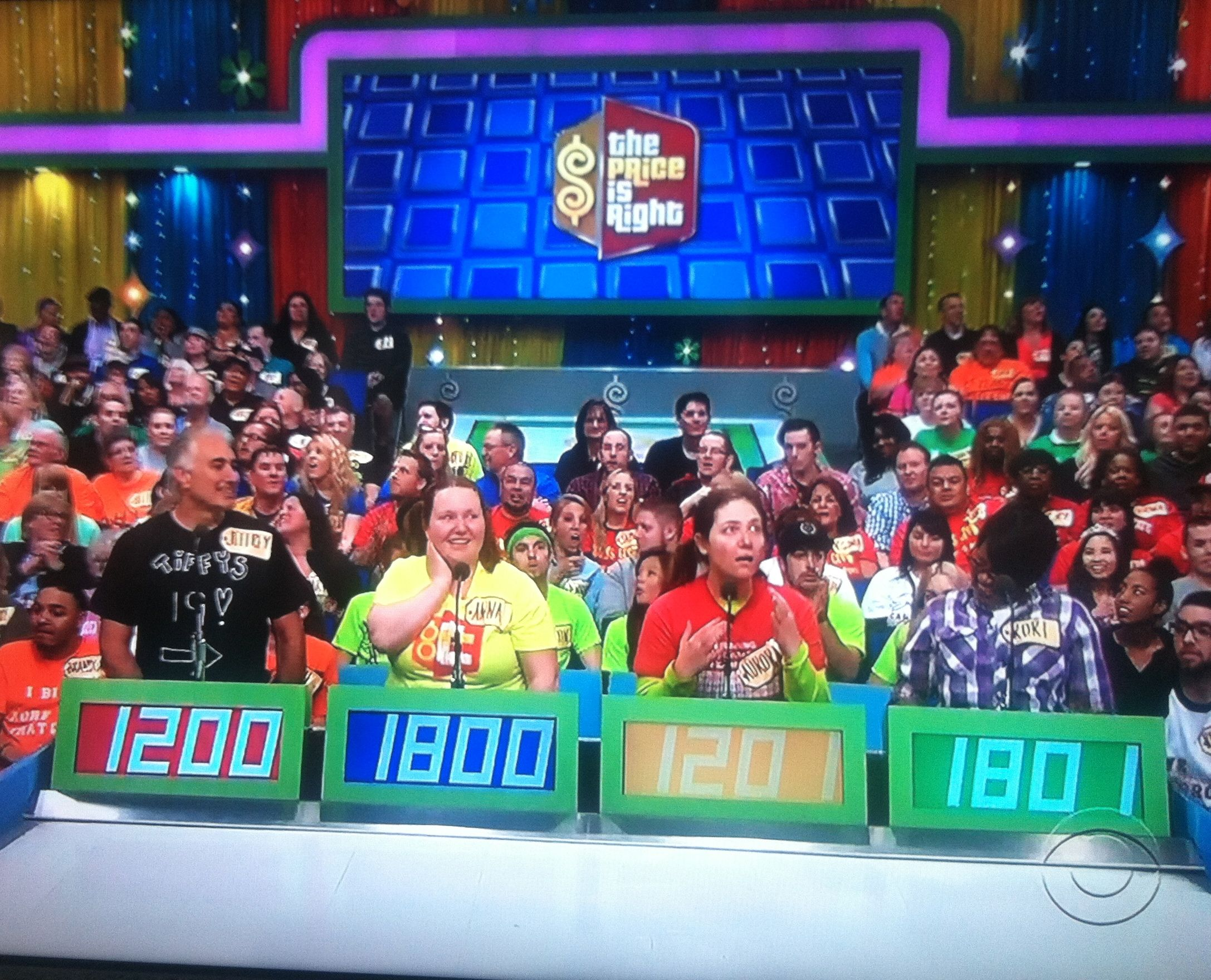 Aurora behind her podium in disbelief that she's the next person up to contestant's row on The Price is Right