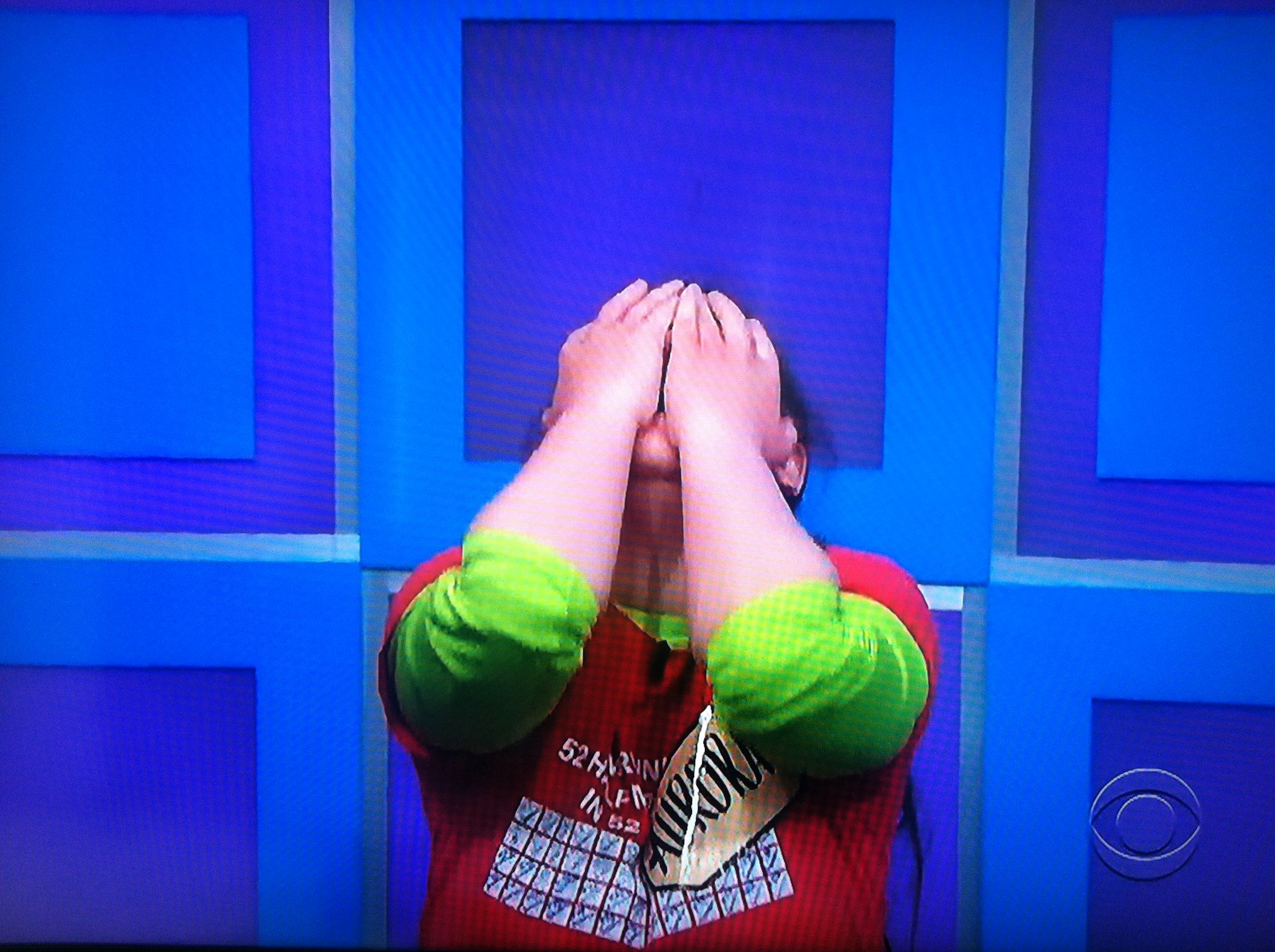 Aurora De Lucia kneeling down with her hands over her face after she learns she's playing for a brand new car on The Price is Right