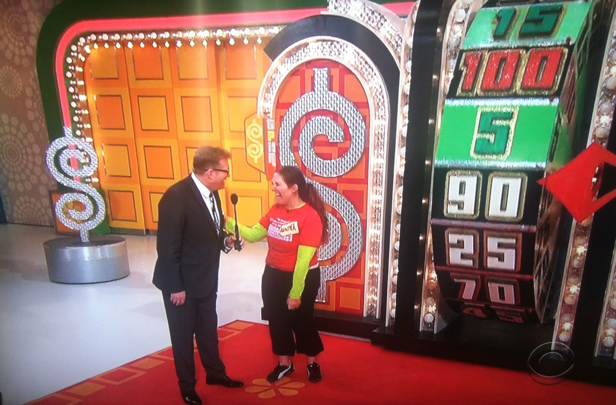 Aurora De Lucia having fun with Drew Carey at The Price is Right wheel