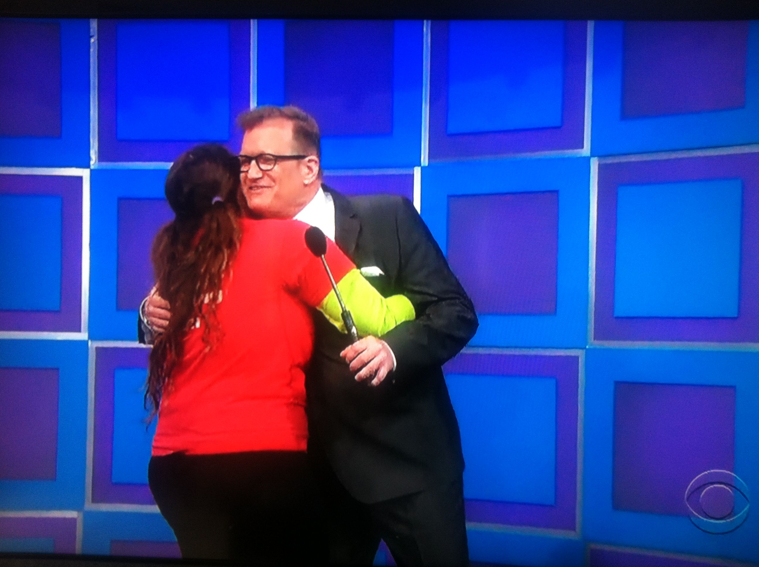 Aurora De Lucia hugging Drew Carey on The Price is Right stage