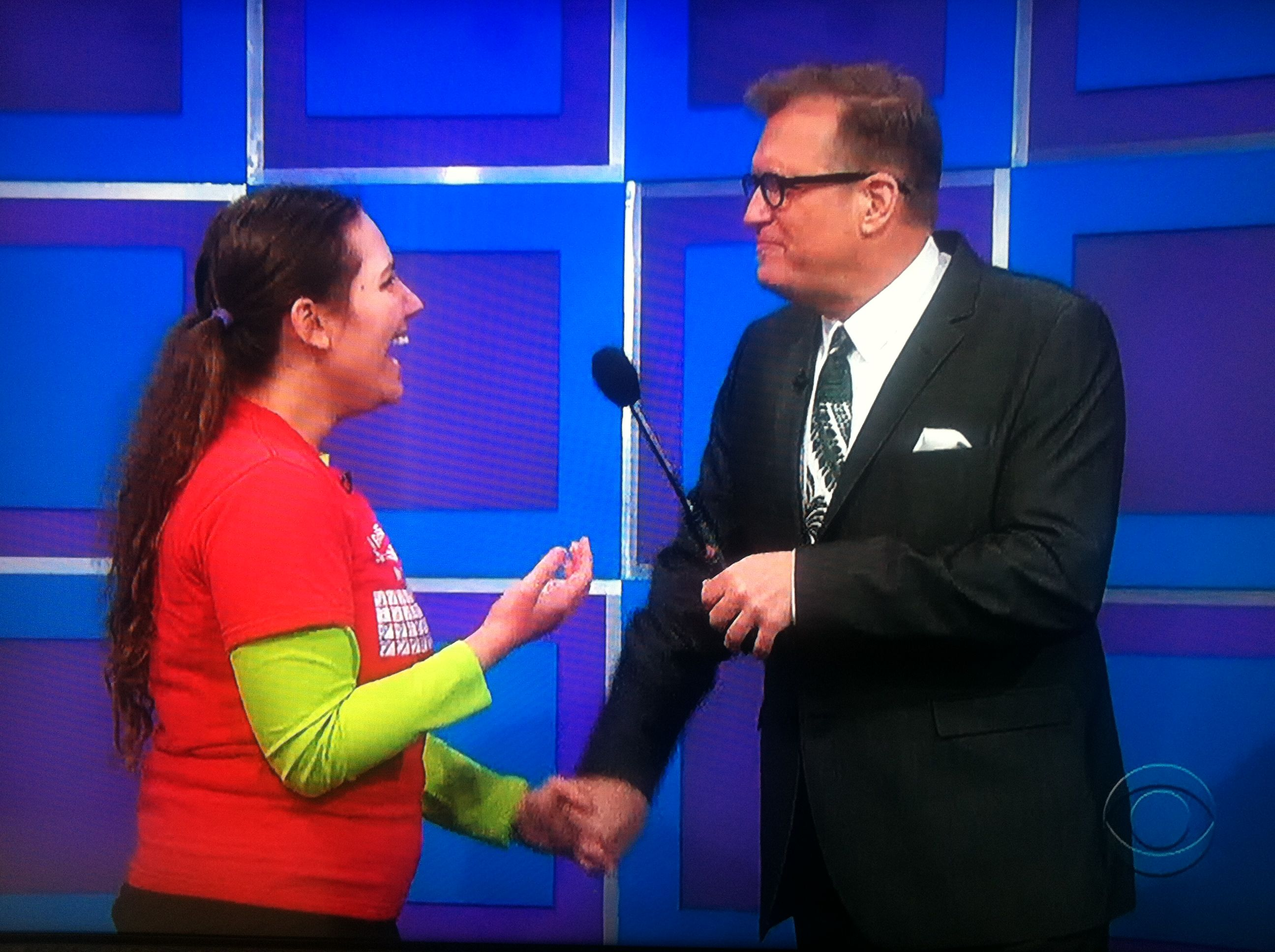 Aurora De Lucia holding hands and talking with Drew Carey on The Price is Right