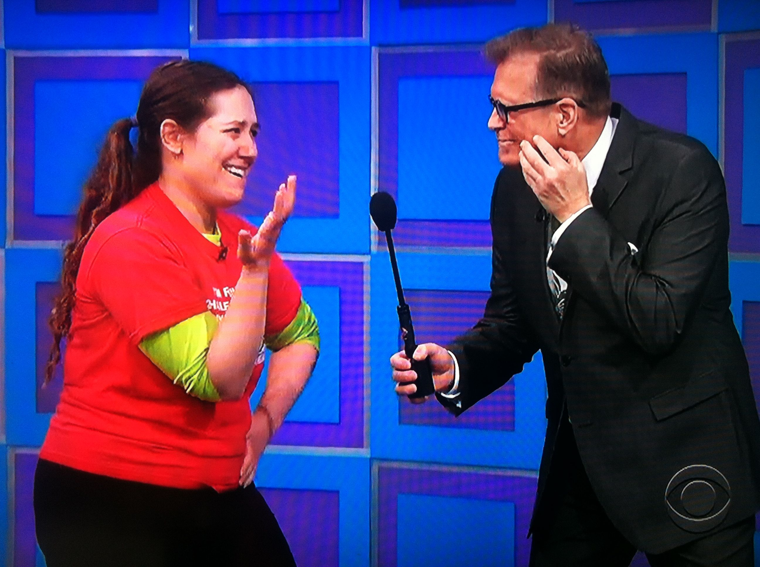 Aurora De Lucia and Drew Carey with their thinking faces on at The Price is Right