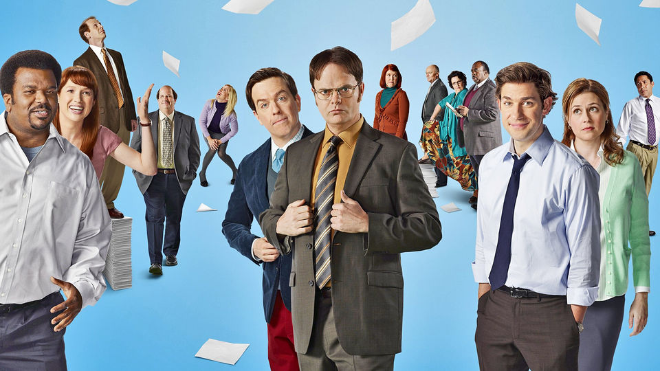 The Cast of The Office in the blue background before the finale