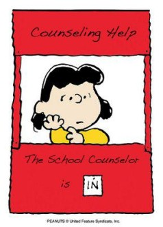 Lucy the Peanuts character sitting at her counseling help booth