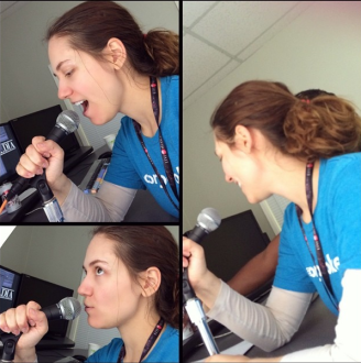 Aurora making voiceover faces into a microphone
