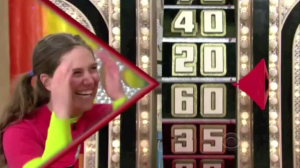 Aurora De Lucia smiling while watching the wheel spin on Price is Right