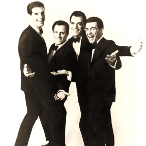 Frankie Valli and the Four Seasons posing together