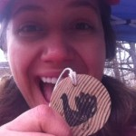 Aurora smiling with her wooden Wittle Waddle medal at the 2012 half marathon