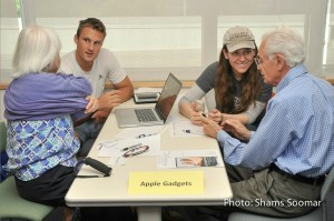 Aurora De Lucia and Mike helping senior citizens learn about Apple products
