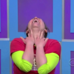 Aurora on the ground at Price is Right with her head lifted up
