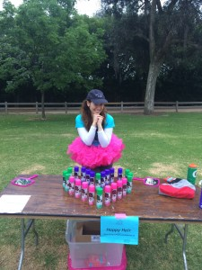 Aurora De Lucia smiling in a tutu at the Girls on the Run Happy Hair Station