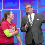 Aurora De Lucia and Drew Carey laughing onstage