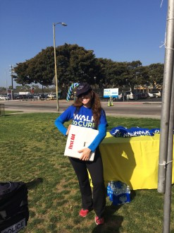 Aurora standing with a first aid kit at the Walk to Cure Arthritis Los Angeles 2014