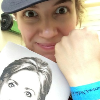 Aurora posing with Hillary Clinton wristband and book before a book signing at The Grove