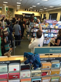 people taking pictures from the back of the line to meet Hillary Rodham Clinton at the Grove in Los Angeles