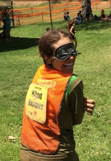 Aurora complete in her muddy clothes and orange blind runner vest with blindfold after the Irvine Lake Obstacle Course run 2014