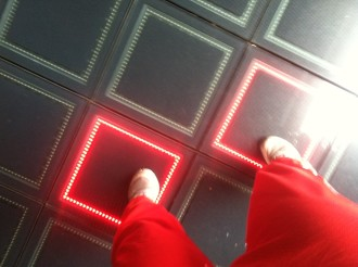 feet dancing on the Billie-Jean-like light up squares outside the Met Lofts