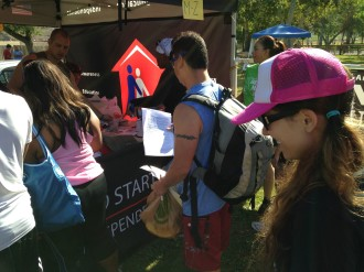 Aurora in line to pick up her race packet at the Irvine Lake Mud Run Obstacle Course 2014