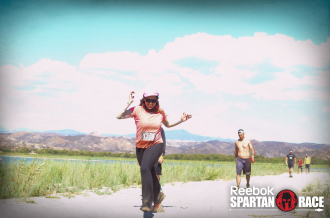 Aurora De Lucia running and smiling at the Spartan Beast in Temecula, CA