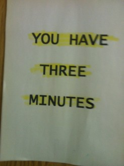 "Sign that says ""you have three minutes"" (highlighted)"