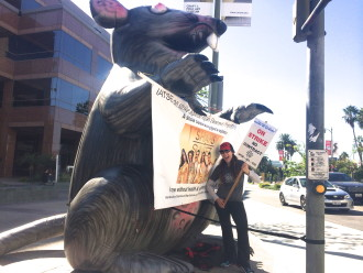 Aurora in front of a rat on an IATSE picket line