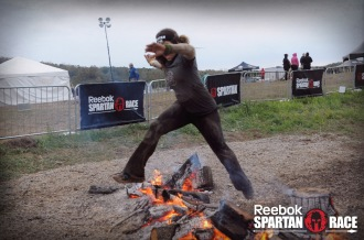 Aurora jumping over fire at the Spartan Ohio Trifecta-in-a-day 2014
