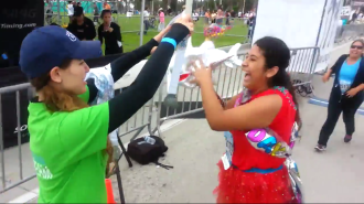 Aurora presending a medal to Gia at the Long Beach 5k 2014