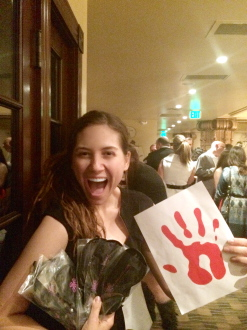 Aurora excited with her red hand sign and blindfolds at The Joshua Project Foundation Dining in the Dark 2014