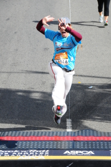 Aurora De Lucia jumping across the finish line of Rock 'n' Roll Los Angeles 2014 (dressed as Mo'ne Davis)