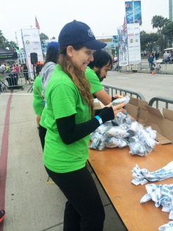 Aurora De Lucia making a silly face while sorting medals at the Long Beach 5k 2014