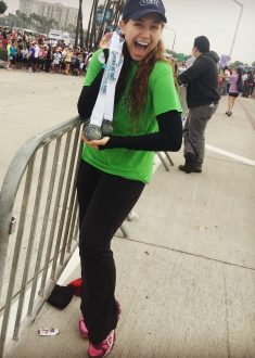 Aurora De Lucia smiling with medals at the Long Beach 5k 2014