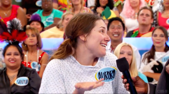 Aurora giving a maybe facial expression and hand gesture on Let's Make a Deal