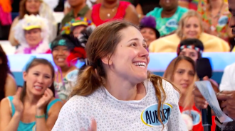 Aurora De Lucia smiling and looking a little confused on Let's Make a Deal