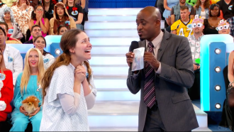 Aurora De Lucia looking with nervous big eyes as her prize is about to be revealed on Let's Make a Deal