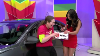 Aurora getting handed her license plate after winning a car on The Price is Right