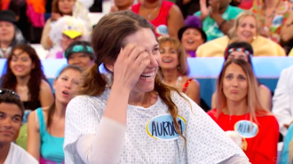 Aurora scratches her eye while looking off-camera on Let's Make a Deal